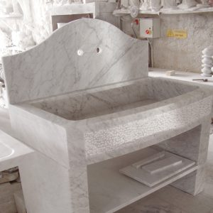 kitchen sink made of white carrara marble