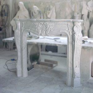 white carrara marble fireplace