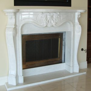 calacatta gold marble fireplace