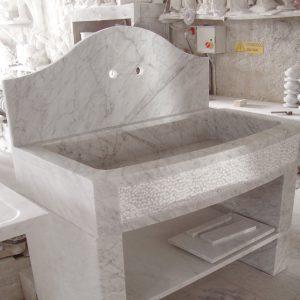 kitchen sink made of white carrara marble